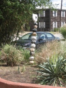 Ceramic sculpture in a garden bed