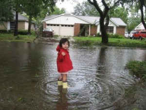 Katya seeing how far into the flood water she can go