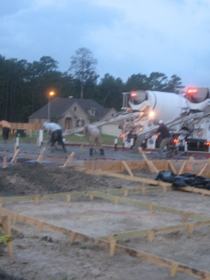 cement trucks pouring foundation