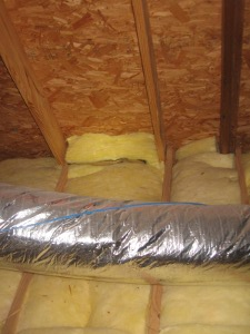insulation against attic sheathing